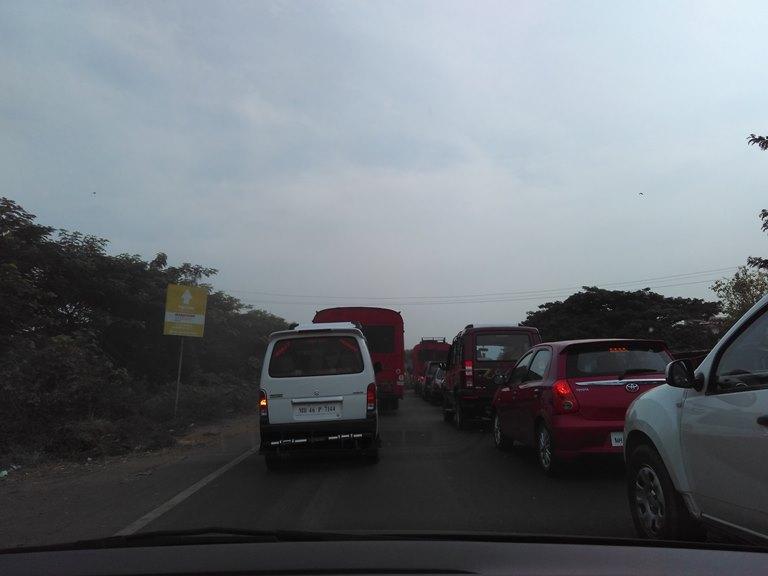 Approaching Panvel from Mumbai-Pune Expressway, turn from under the flyover. Display board of Marathon Nexzone