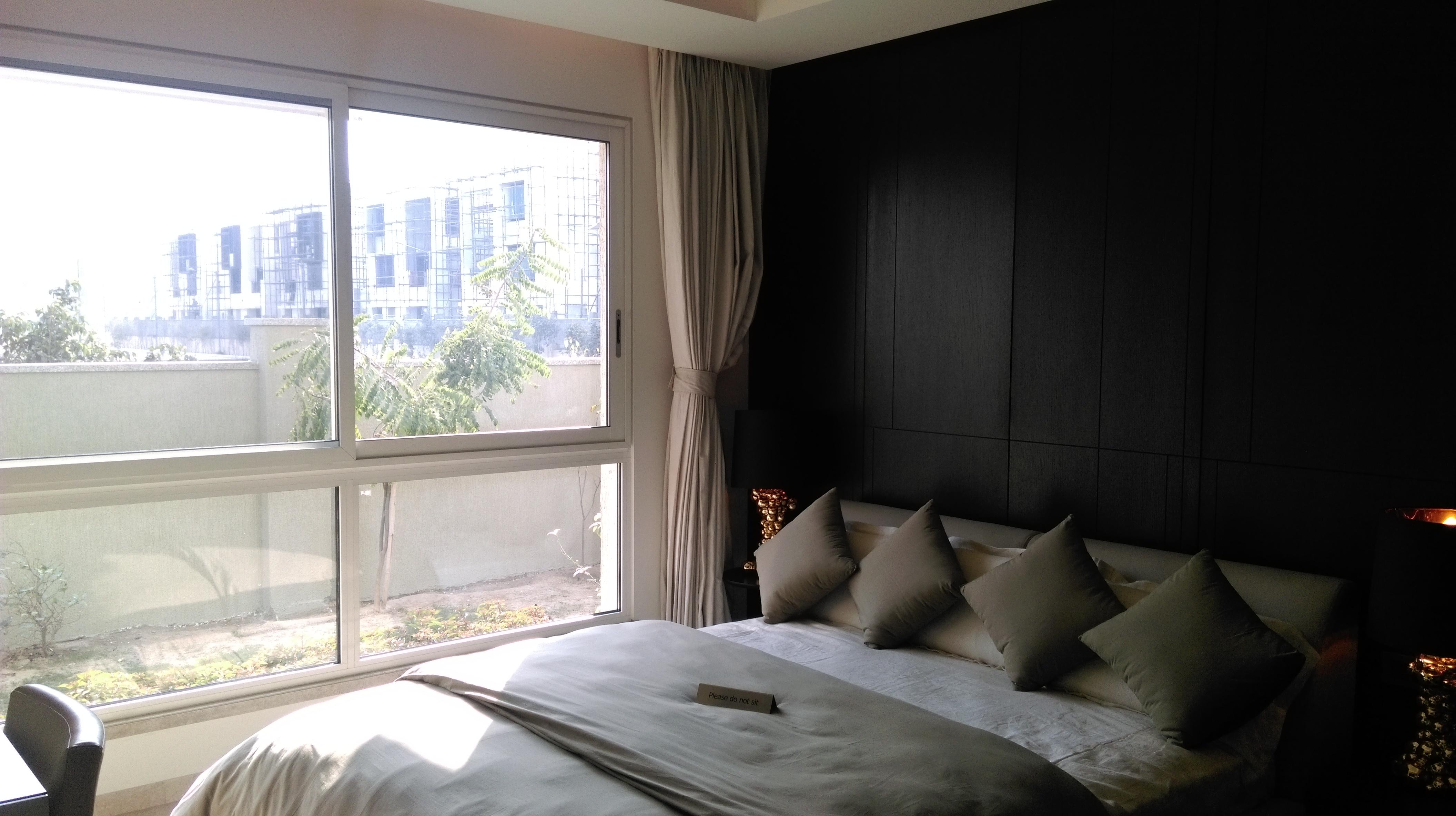 Bedroom facing rear lawn at Sobha International City Presidential Villa