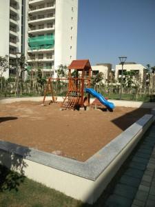 Sobha international city row houses : sandpit for children in row housing block.