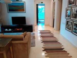 Living room in sample apartment, Brigade Cosmopolis