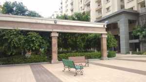 Wrought iron benches set in central park, Godrej Woodsman Estate