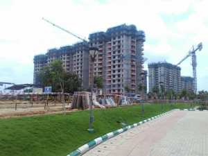Purva Palm Beach by Puravankara Group -- view of the building under construction from inside the Purva Palm Beach site.