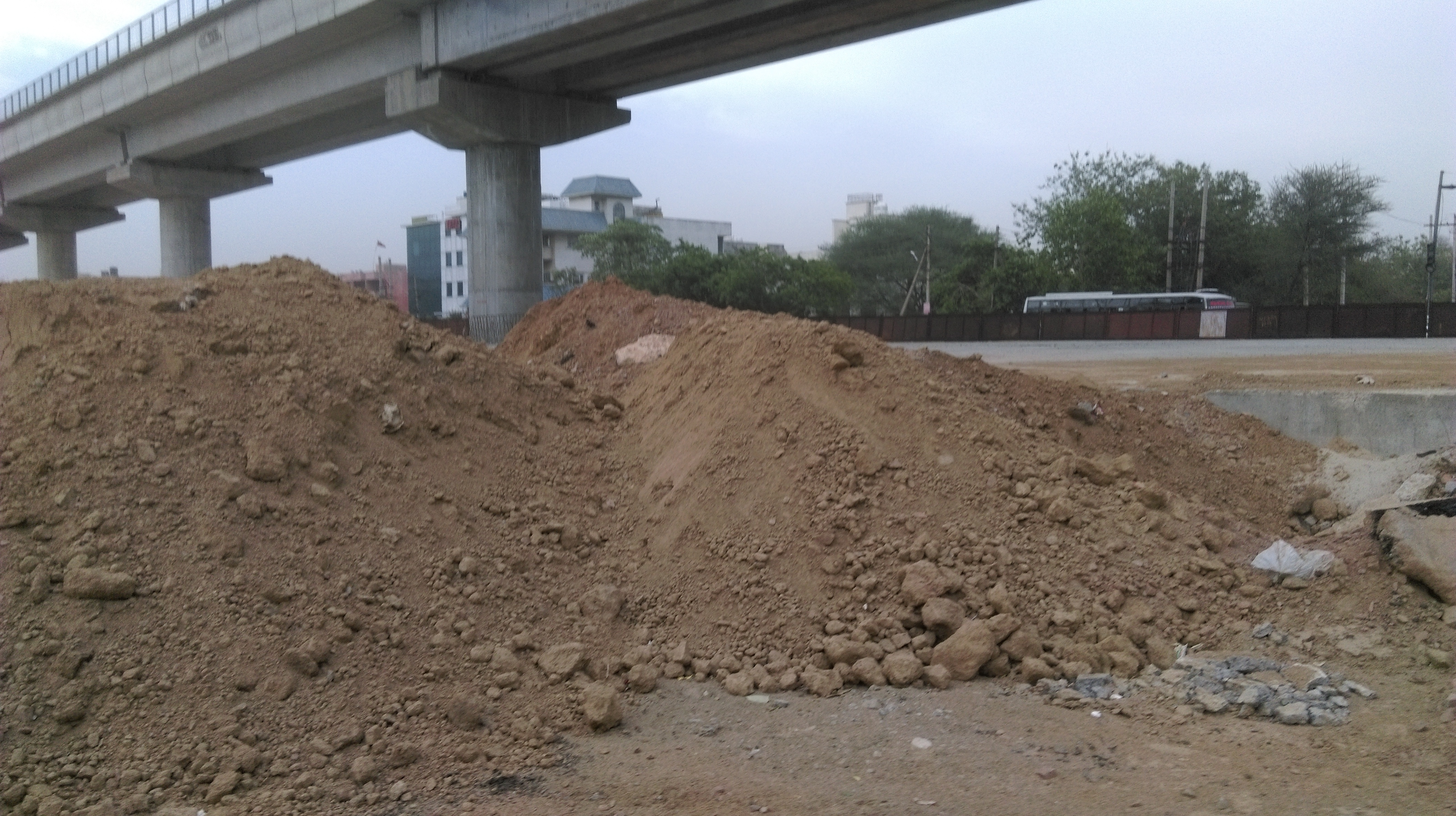 Mounts of debris along the road on Golf Course Gurgaon