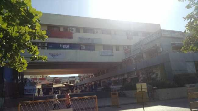 View of Destination Centre in Magarpatta City, with shoppers walking around