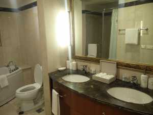 Washrooms with automated lighting systems - Sample Apartment, Central Park Resorts