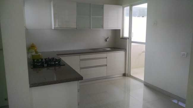 Open plan kitchen in sample apartment of Rohan Abhilasha project in Wagholi, Pune
