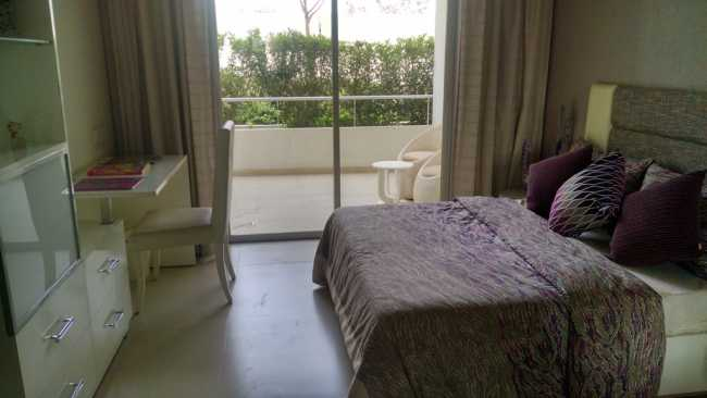 Bedroom with attached terrace in sample apartment of Rohan Abhilasha project in Wagholi, Pune