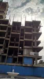Under-construction apartment tower at Akshardham project in Market Yard, Pune