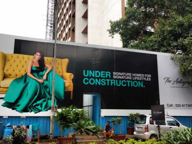 Advertising hoarding outside The Autograph project site